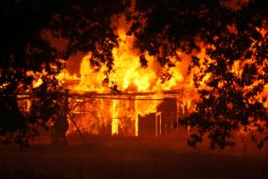A structure burns out of control in the River Fire in Lakeport